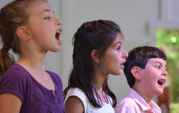 Young children singing.