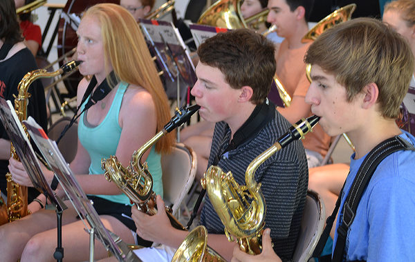 Teens playing in a wind ensemble.