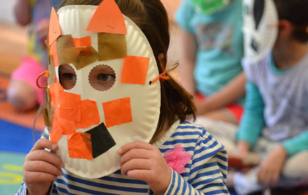 Young child wearing a mask.