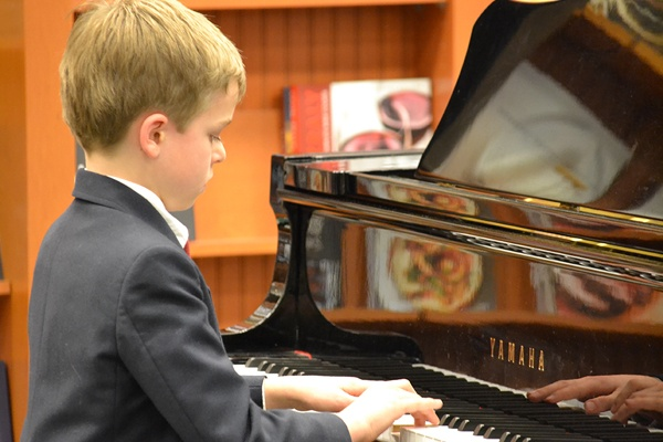 SSC piano student performing in a recital.