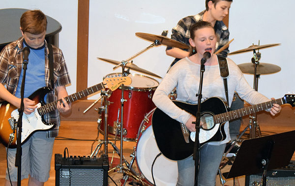Middle School Monster Jam kids playing in a rock band.