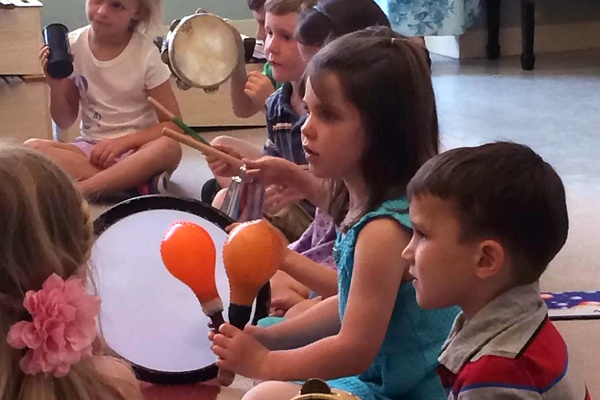 Children playing percussion instruments.