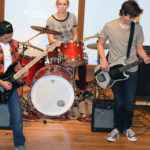 Open Mic Night teen rock band performing.