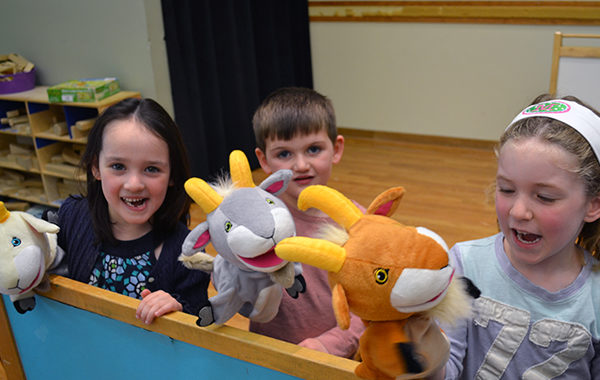 Children playing with hand puppets.